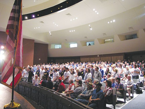 """JAMES CHILTON/Miner<BR><BR> Almost all the Kingman High School students in attendance at the school's Tuesday Veterans Day tribute ended up standing when Principal Pat Mickelson asked for anyone who has a veteran in their family to do so. <BR><a href=""""Formlayout.asp?formcall=userform&form=20""""target=""""_blank"""">Click here to purchase this photo</a>"""