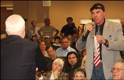 "JC AMBERLYN/Miner Luca Zanna (above) and Howard Melendez voice frustration during Friday's town hall meeting in the County Administration Building with U.S. Sen. John McCain.  <b><a href=""http:kingmandailyminer.com/Formlayout.asp?formcall=userform&form=20"">Click here to purchase this image as a print or photogift</a></b>"