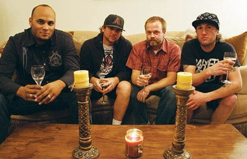 """JC AMBERLYN/Miner<BR><BR> Mohave County-based rock band The Asphalt hope to bring their search for unique dining experiences to living rooms across the country in a new cable television show set to enter production early next year. Pictured from left to right are: Lead guitarist Jason Marino, lead vocalist Randy Mazick, bassist Jon Statler and drummer Nick Turner.<BR><a href=""""Formlayout.asp?formcall=userform&form=20""""target=""""_blank"""">Click here to purchase this photo</a>"""