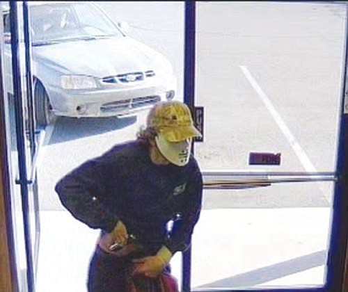 Courtesy<BR><BR> This Oct. 16 surveillance footage from the National Bank of Arizona shows the armed robbery suspect.