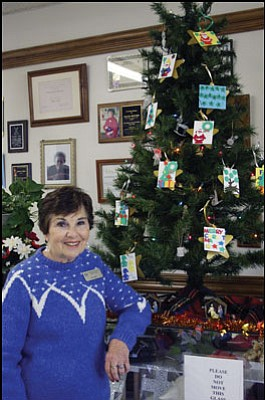 JC AMBERLYN/Miner<br> Kathleen Green, a staff member at Kathryn Heidenreich Adult Center, stands by the Senior Angel Tree Friday.