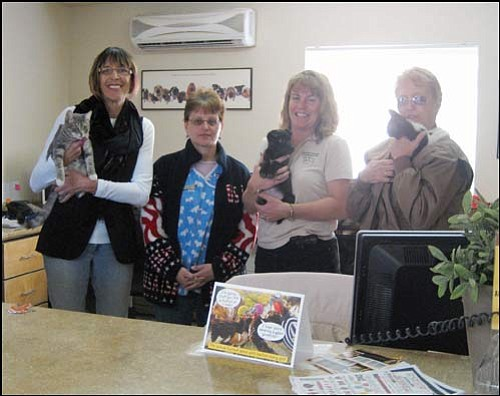 "SUZANNE ADAMS/Miner<br> The adoption numbers are up at the Kingman Animal Shelter, but Western Arizona Humane Society still needs the public's help. Pictured are WAHS Director Victoria Cowper, Pat Knudson, WAHS Kingman Shelter Manager Erin Kenyon and Marilyn Skarphol.   <a href=""http://kingmandailyminer.com/Formlayout.asp?formcall=userform&form=20"">Click here to purchase this photo</a>"