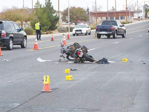 Courtesy<br> Police work the scene of a fatal hit and run accident on Andy Devine Avenue Monday afternoon.