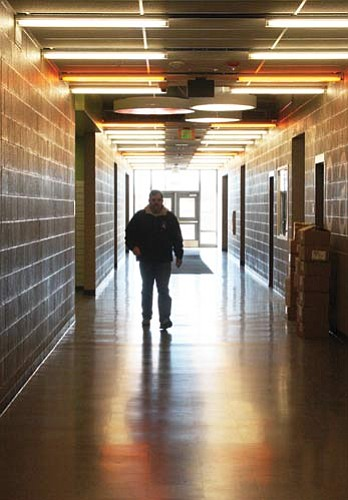 """JC AMBERLYN/Miner<BR><BR>  Principal John Venenga walks through the hallways of the new White Cliffs Middle School Wednesday.<BR><a href=""""http://kingmandailyminer.com/Formlayout.asp?formcall=userform&form=20"""">Click here to purchase this photo</a>"""