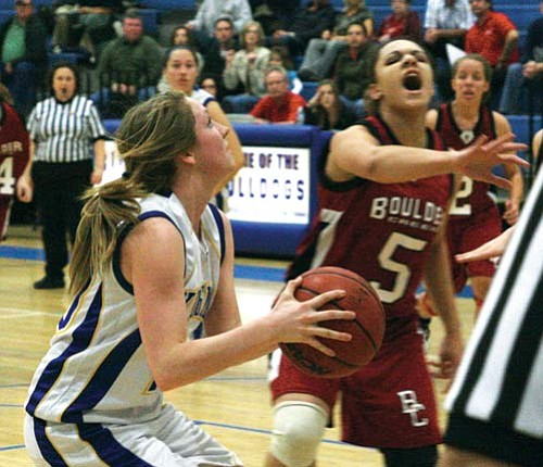 "JC AMBERLYN/Miner<BR><BR> Kingman High's Michelle Bracy looks to get a shot off before Boulder Creek's Brittany Allen can close the door during the Lady Bulldogs' 60-40 win over the Jaguars Friday at KHS. The Lady Bulldogs are currently riding a 10-game winning streak.<BR><a href=""http://kingmandailyminer.com/Formlayout.asp?formcall=userform&form=20"">Click here to purchase this photo</a>"