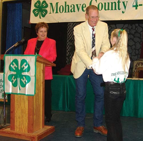 Courtesy<BR><BR> Supervisor Gary Watson presents the Achievement Award to Miekhylla Pruett of The Stockton Hill Herd 4-H Club at the 2009 Annual 4-H Recognition program. Looking on is City Councilwoman Janet Watson.