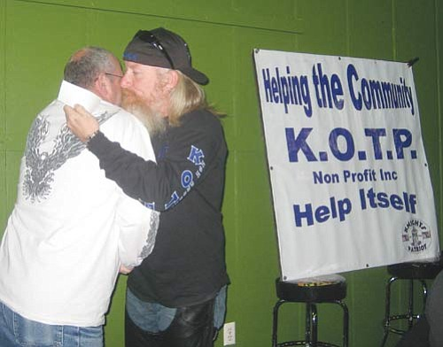 "ERIN TAYLOR/Miner Loren Larson, left, of the Patriot Guard Riders, accepts a $200 donation from Daniel Swaine of KOTP non-profit at the group's weekly meeting Friday.  <a href=""http://kingmandailyminer.com/Formlayout.asp?formcall=userform&form=20"">Click here to purchase this photo</a>"