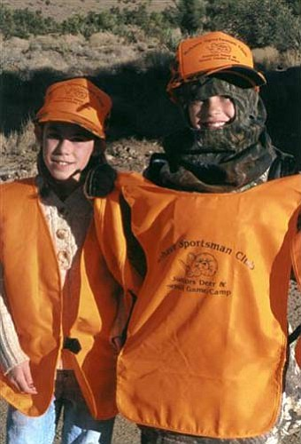 DON MARTIN/For the Miner<br> Meghan Wagner of Kingman and Jennah Kiviahde of Flagstaff show the safety vests and hats they received while attending the Mohave Sportsman Club's junior's muzzleloader deer and small-game camp.