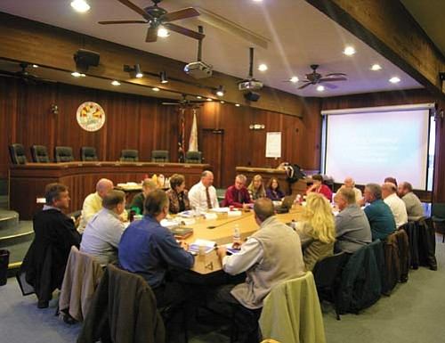 "JAMES CHILTON/Miner<br> The Kingman City Council, along with various department heads and support staff, discuss what to prioritize over the coming year in the city's $250 million capital improvement projects wish list Thursday morning. <a href=""http://kingmandailyminer.com/Formlayout.asp?formcall=userform&form=20"">Click here to purchase this photo</a>"