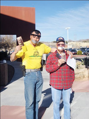 "SUZANNE ADAMS/Miner<br>  Mohave County residents Luca Zanna (left) and Dean Jacobs protested the county's policy prohibiting political activity on county property during Monday's Board of Supervisors meeting with duct tape and copies of the Constitution.  <a href=""http://kingmandailyminer.com/Formlayout.asp?formcall=userform&form=20"">Click here to purchase this photo</a>"