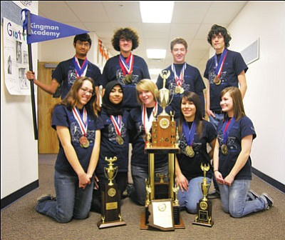 "JAMES CHILTON/Miner<br> Kingman Academy of Learning Academic Decathlon team members pose with the hardware they won in the regional competition held in Pine Top Feb. 5-6. <a href=""http://kingmandailyminer.com/Formlayout.asp?formcall=userform&form=20"">Click here to purchase this photo</a>"