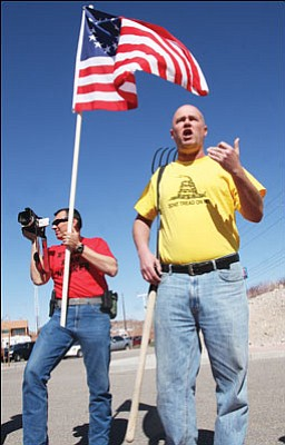 JC AMBERLYN/Miner Mervin Fried speaks to a crowd Tuesday as Luca Zanna records the protest against recent county actions. Fried was later arrested for misdemeanor trespassing when he attempted to enter the County Administration Building with the pitchfork slung over his shoulder. He was later released on bond.