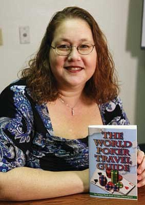 "JC AMBERLYN/Miner<br><br/>Author Tanya Peck will sign copies of her book, ""The World Poker Travel Guide,"" from 6 to 8 p.m. today at Lombardo's, 710 Eastern Ave.<br/><a href=""http://kingmandailyminer.com/Formlayout.asp?formcall=userform&form=20"">Click here to purchase this photo</a>"
