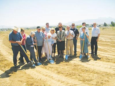 "May 2009 -<br/>AARON ROYSTER/Miner<br/>(From left) Tod and Lorilee Becker, Diana and Dr. John Lingenfelter, Monica Busch, Betty Grounds, Jeff Katen, Linda Short, Mike Morfeld, Krystal Burge, Toby Orr, Keith Walker, June Schultz, Brian Turney and Pete Profit break ground Monday on the Joan and Diana Hospice Home. <br/><a href=""http://kingmandailyminer.com/Formlayout.asp?formcall=userform&form=20"">Click here to purchase this photo</a><br/>"