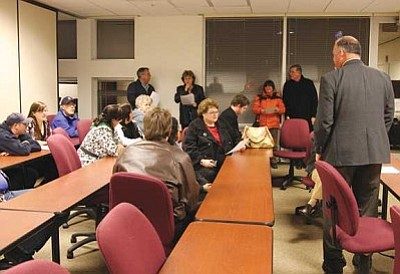 "JC AMBERLYN/Miner<br/>Mayor John Salem, right, discusses the results of the Primary Election Tuesday night at the County Administration Building. <br/><a href=""http://kingmandailyminer.com/Formlayout.asp?formcall=userform&form=20"">Click here to purchase this photo</a>"