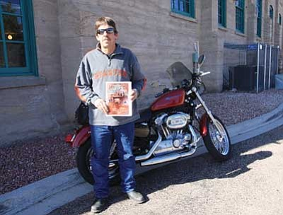 JC AMBERLYN/Miner<br/>Kirk Slack of Out West Family Films stands by a motorcycle at the Kingman Powerhouse Thursday morning. His latest film is about the Mother Road.