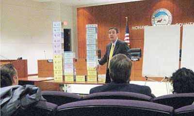 Courtesy<br/>Secretary of State Ken Bennett uses tissue boxes to illustrate state spending in a meeting Wednesday.