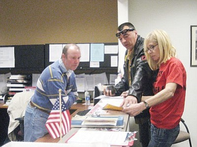 SUZANNE ADAMS/Miner<br/><br/>County Elections Director Allen Tempert explains what Golden Valley residents Luca Zanna and Bridget Langston must do in order to collect more than 3,700 signatures to recall Tom Sockwell. Zanna pulled the recall petition paperwork Monday morning.