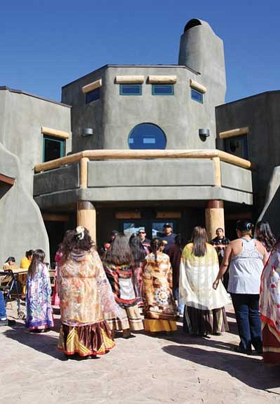 """JC AMBERLYN/Miner<br/>Bird Singers and Hualapai dancers celebrate the Grand Opening of the Hualapai Cultural Center in its courtyard Friday. <br/><a href=""""http://kingmandailyminer.com/Formlayout.asp?formcall=userform&form=20"""">Click here to purchase this photo</a>"""