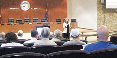 SUZANNE ADAMS/ Miner<br><br/>Arizona Town Hall President Tara Jackson speaks to a small crowd at an event Wednesday. The organization was collecting public comments about Arizona's revenue crisis. <br/>
