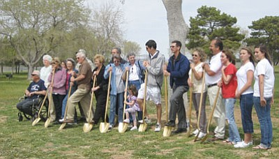 SUZANNE ADAMS/ Miner<br/>Family, friends, and survivors gathered Monday in Firefighter Memorial Park to break ground on a new memorial, which will honor the lives of 11 firefighters and one civilian who were killed in the Doxol propane explosion on July 5,1973.