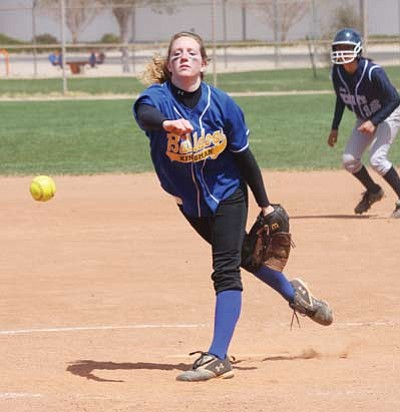 JC AMBERLYN/Miner<br />Michelle Bracy fires one in for Kingman High during the Lady Bulldogs' 18-6 win over Window Rock Saturday at Centennial Park in the 2010 Kingman Pepsi Softball Classic. Bracy went 2-0 in the tournament for KHS, and Kylie Ostermeier was 1-1.<br />