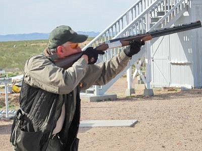 DON MARTIN/For the Miner<br />Al Daum of Kingman was the picture of concentration while competing in a shoot-off with MSC President Steve Bell for second place in the skeet shooting event at the Maywood challenge match. Daum won the shoot-off by a single target.