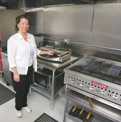 JAMES CHILTON/Miner<br /><br /><!-- 1upcrlf2 -->Dora Manley, the former proprietor of the Kingman Deli, stands in the kitchen at the Chef's Kitchen building at 509 Beale St. Manley, who recently moved back to Kingman from Phoenix, will reopen the deli at the Chef's Kitchen under a new name later this summer.