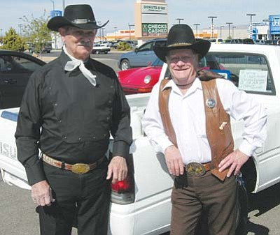 JAMES CHILTON/Miner<br /><br /><!-- 1upcrlf2 -->Hondo Johnson and Cheyenne Cooper, pictured Friday outside the Starbucks at Kino Avenue and Stockton Hill Road, are the leaders of a new gunfighting troupe that has used a series of local job fairs to fill its ranks. With decades of firearms and stuntman experience between them, Johnson and Cooper are hopeful they can train a new crop of realistic gunfighters to be hired as local entertainment.<br /><br /><!-- 1upcrlf2 -->