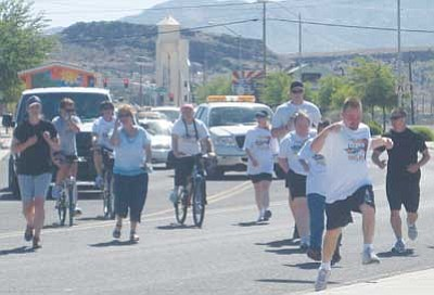 ERIN TAYLOR/Miner<br /><br /><!-- 1upcrlf2 -->Athletes from the Route 66 Special Olympics group join runners and bicyclists from the Kingman Police Department and Arizona State Prison-Kingman during the Law Enforcement Torch Run for Special Olympics near the Powerhouse Visitor's Center Monday morning.