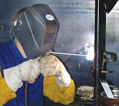 Courtesy<br /><br /><!-- 1upcrlf2 -->A Mohave Community College welding student practices his technique in a laboratory class at MCC's Kingman campus. The MCC welding program will be restructured this fall to give students more time in a classroom setting and less time in the lab so they can better prepare for industry tests they must pass to get a job in the trade.