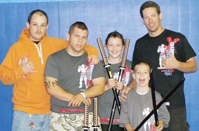 Courtesy<br /><br /><!-- 1upcrlf2 -->Champion Fight Team went to Mesa and took five first-places. They were awarded with samurai swords. The team, from left, is Bradly Horn, Orrin Lancaster, Jessica Hurst, A.J. Alexander and David Alexander.