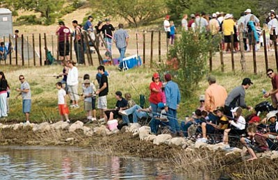 Courtesy<br /><br /><!-- 1upcrlf2 -->Children and their parents fish at Yellow Pine Ranch during last year's Fishing for Smiles event, put on by the Elks Lodge and Arizona Game and Fish. Registration for this year's event runs through Saturday, June 5.