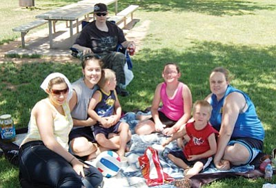 SHAWN BYRNE/Miner<br /><br /><!-- 1upcrlf2 -->There were many ways to try to beat the heat over the past three days, and from left, Ashley Mulverhill, Jaime Alvarado, Joshua Mulverhill, Jazmine Skaro, Anthony Mulherhill, Tricia Mulverhill, and in back, Martin Mulverhill, did it with a picnic under the shade of a tree at Centennial Park Monday.