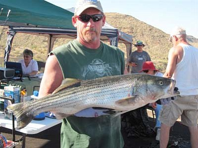Mike Van Zant with his fish weighing 18.10 pounds, which is the largest fish ever checked in during a Stripe-R-Rama tournament