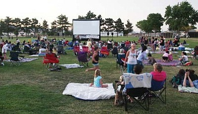 Photos by JC AMBERLYN/Miner<br> Families get ready for the movie Saturday evening.