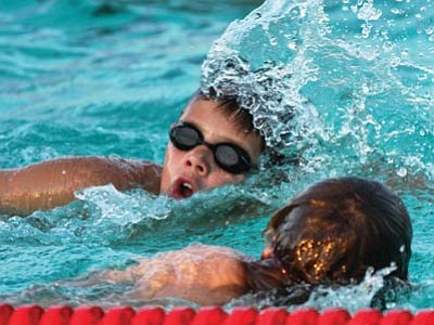 JC AMBERLYN/Miner<br> The Kingman Dolphins Swim Team held their annual Swim-a-Rama Tuesday at Centennial Pool as members of the team raised funds for the organization. The team wants to let parents know it's not too late to get their kids involved with the team. Pictured here, Giancarlo Narvarte, 10, was scheduled for 200 laps at the Swim-a-Rama.