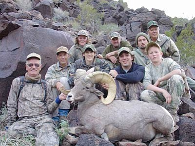 "DON MARTIN/For the Miner -- Christopher Reeves, (second row, second from the left) was our ""Superman."" Here he is with his ram and part of the team that made his hunt successful."