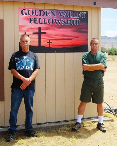 SUZANNE ADAMS/Miner -- Kenny Alsup and Mark Armstrong, founders of Golden Valley Fellowship, pose beside the church's new home on Houck Road.