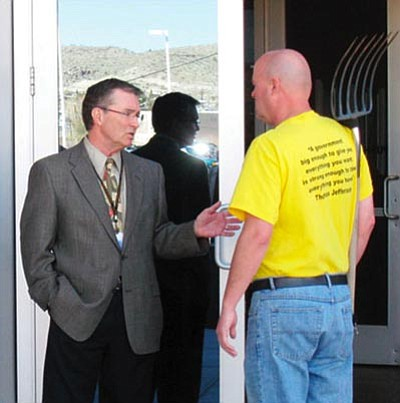 Paul Frankfurter/Courtesy -- Mohave County Manager Ron Walker stops Mervin Fried at the doors to the County Administration Building Feb. 16 following a rally against the county's new policies against politicking and guns on county property. Walker asked Fried to leave his pitchfork outside. When Fried refused he was arrested on charges of trespassing. <br /><br /><!-- 1upcrlf2 -->