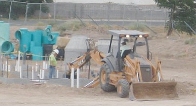 ERIN TAYLOR/Miner<br /><br /><!-- 1upcrlf2 -->Crews digging a sewer line for the city of Kingman unearthed remains from the former Pioneer Cemetery this week on what used to be the southern end zone of the Lee Williams football field.