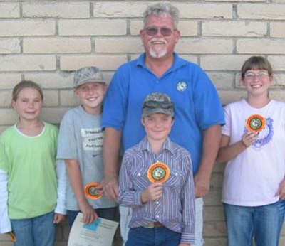 Courtesy -- These four youngsters were chosen as the honor graduates from the hunter education class taught over two weekends at the Mohave Sportsman Club's Seven Mile Hill Range. From left is Taylor Harrison, Sadie Snay, chief instructor Don Martin and Kirsten Molt Bass.<br /><br /><!-- 1upcrlf2 --><br /><br /><!-- 1upcrlf2 -->