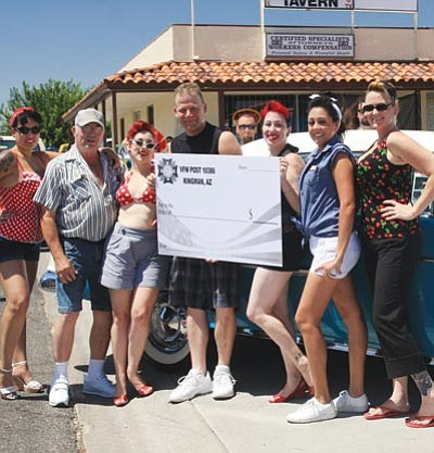 "Standing with a blank check (to filled out later when results were available) are (from left): ""Mandy JC AMBERLYN/Miner -- Mischief,"" Time Out Tavern owner John Wickland, ""Michele Del Ray,"" Art Stiers of L.A. Sounds, ""Cherry Darling,"" ""Ember Dee"" and ""Dawn Aken."""
