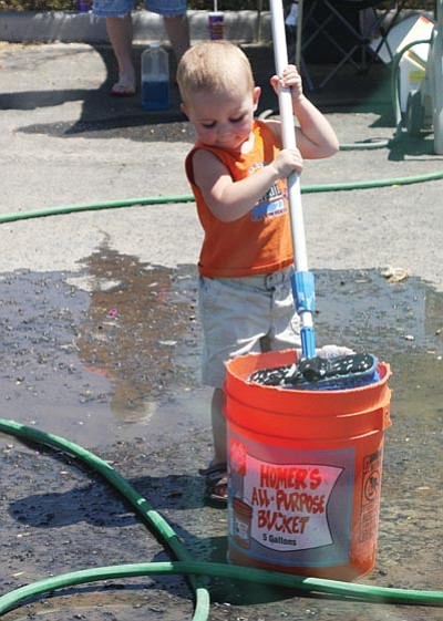 JC AMBERLYN/Miner -- Thomas Long, 2, was determined to help out.