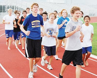 SHAWN BYRNE/Miner -- The Kingman High cross country teams are crowded with runners as shown at Tuesday's practice at KHS. The boys and girls teams have a combined total of more than 35 runners this year.<br /><br /><!-- 1upcrlf2 -->