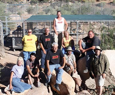 Keepers of the Wild/courtesy -- Keepers of the Wild Founder and Director Jonathan Kraft, seated center, poses with staff and a film crew that recently came to the nature park to film footage for a documentary on the treatment of wild exotic animals.