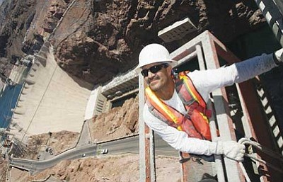"JC AMBERLYN/Miner<br /><br /><!-- 1upcrlf2 -->The Hoover Dam Bypass Bridge is nearing completion. Here, Arturo Caro works on the bypass Thursday afternoon. He was suspended over the edge of the bypass by some cables. The bypass is expected to open to motorists in early November. <b><a href=""http://kingmandailyminer.com/Formlayout.asp?formcall=userform&form=20"">Click here to purchase any of these gallery images as prints or photo gifts</a></b>"