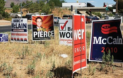 JC AMBERLYN/Miner -- Several candidate's signs photographed in a vacant lot along Stockton Hill Road and I-40 on Friday. The primary election is Tuesday.