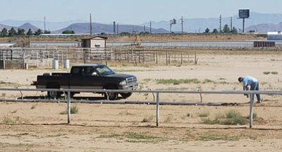 JC AMBERLYN/Miner -- Workers dismantle the horse racing track Friday morning at the Mohave County Fairgrounds.<br /><br /><!-- 1upcrlf2 --><br /><br /><!-- 1upcrlf2 -->