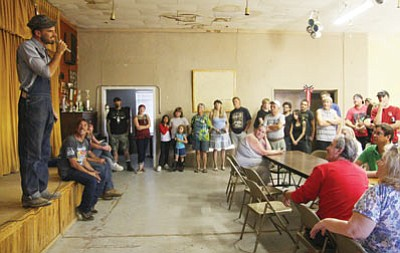 "JC AMBERLYN/Miner -- Mark Maggiori (left) speaks to a crowd of people at the Chloride Town Hall in Chloride on Thursday evening. Maggiori is the director of a new movie, ""Johnny Christ,"" about to film in Chloride. Kirk Slack (seated next to Maggiori) of Slack Productions out of Chloride is the production assistant, scouting out locations for the film, local auditions and other tasks."
